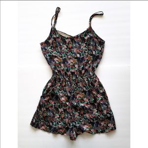 Divided black and flora romper